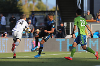 SAN JOSE, CA - SEPTEMBER 29: Seattle Sounders  FC goalkeeper Stefan Frei #24 takes the ball away from Danny Hoesen #9 of the San Jose Earthquakes during a Major League Soccer (MLS) match between the San Jose Earthquakes and the Seattle Sounders on September 29, 2019 at Avaya Stadium in San Jose, California.