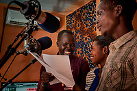 Eye Radio broadcasters From left, CLEMENT LOBOI LOTIANG, VIOLA ELIAS AND MULU FRANCIS, record a radio commercial at their Juba station in South Sudan. In an effort to build up media and encourage a free media, USAID funded the station which is run by Internews.