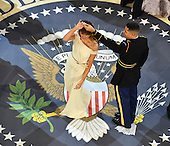 First Lady Melania Trump dances with a Marine at the A Salute to Our Armed Services Ball on January 20, 2017 in Washington, D.C. Trump will attend a series of balls to cap his Inauguration day.      <br /> Credit: Kevin Dietsch / Pool via CNP
