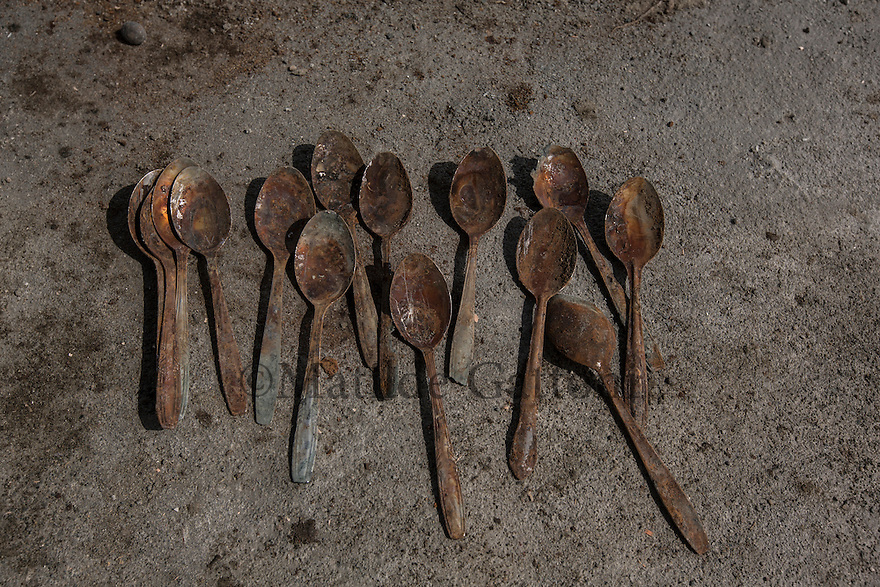 Indonesia - Sumatra - Aceh - Padang Seurahet - A set of spoons has been found by a local man who was digging in the area in order to build a house, these spoons are beiled to have been burried by the tsunami since no one has been living in this area since then.