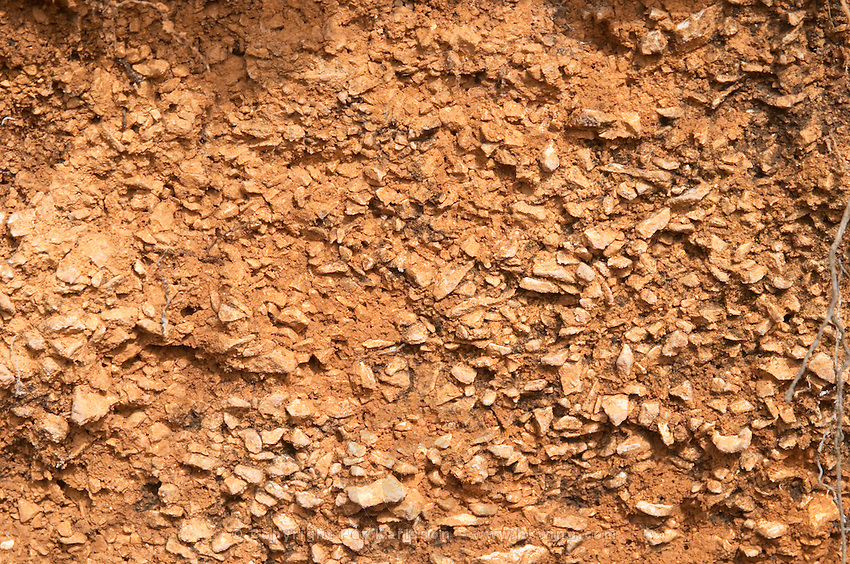 A cross section of the soil, said to be similar to Burgundy (or did he mean Bordeaux?) soil. Domaine du Mas de Daumas Gassac. in Aniane. Languedoc. Terroir soil. France. Europe. Vineyard. Soil with stones rocks. Sand.