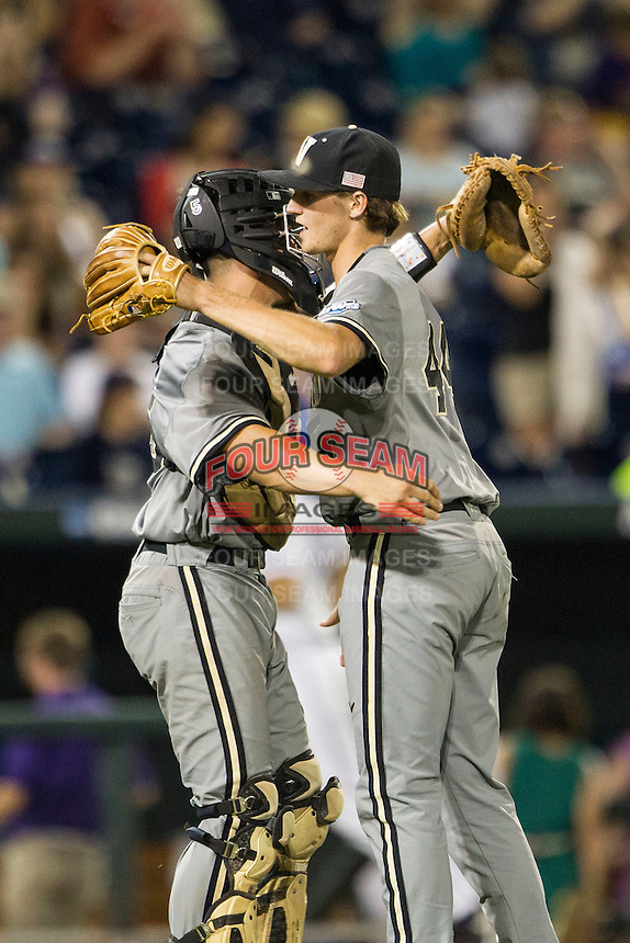 Vanderbilt Commodores pitcher Kyle Wright (44) celebrates with catcher Karl Ellison (25) following the NCAA College baseball World Series against the TCU Horned Frogs on June 16, 2015 at TD Ameritrade Park in Omaha, Nebraska. Vanderbilt defeated TCU 1-0. (Andrew Woolley/Four Seam Images)