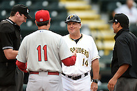 Bradenton Marauders manager Tom Prince (14) talks with former teammate Dann Bilardello (11) during the lineup exchange before a game against the Palm Beach Cardinals on April 8, 2014 at McKechnie Field in Bradenton, Florida.  Bradenton defeated Palm Beach 4-3.  (Mike Janes/Four Seam Images)
