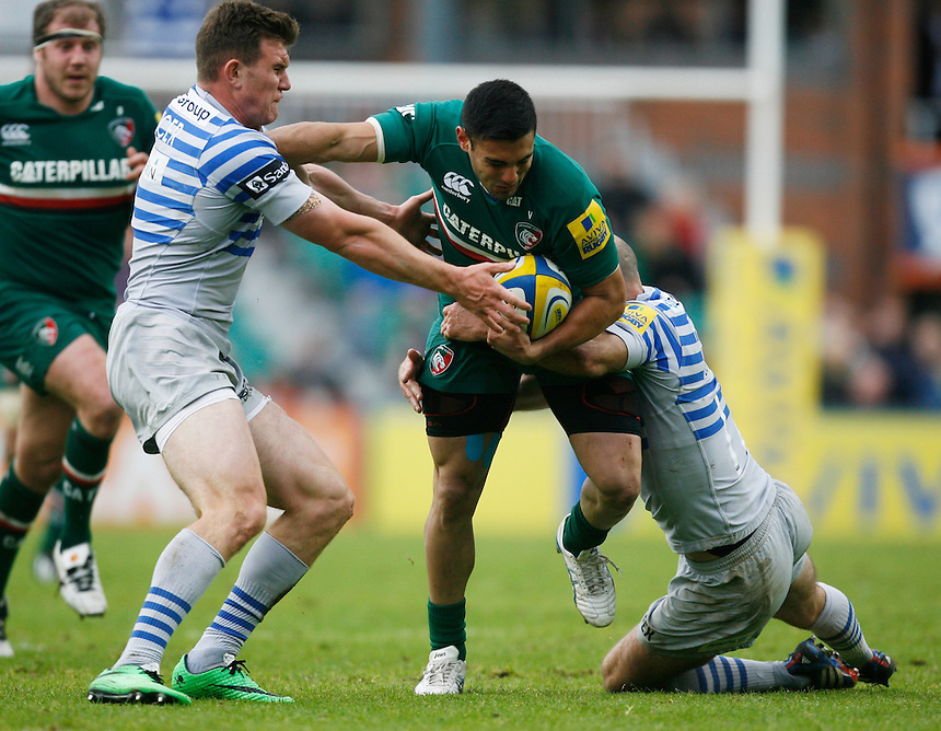Leicester Tiger Dan Bowden (C) is tackled  by Saracen Charlie Hodgson (R)<br /> <br /> Photo by Jack Phillips/CameraSport<br /> <br /> Rugby Union - Aviva Premiership - Leicester Tigers v Saracens - Saturday 10th May 2014 - Welford Road - Leicester<br /> <br /> &copy; CameraSport - 43 Linden Ave. Countesthorpe. Leicester. England. LE8 5PG - Tel: +44 (0) 116 277 4147 - admin@camerasport.com - www.camerasport.com