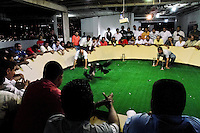 Spectators, mainly members of the Colombian high society, watch a private cockfight held in the arena in Cucuta, Colombia, 2 May 2006. Cockfight is a widely popular and legal sporting event in much of Latin America. The fight is usually held in an arena (gallera) with seats for spectators. There is always gambling involved in cockfights. People take advantage of cock's natural, strong will to fight against all males of the same species. Birds are specially bred to increase their aggression and stamina, they are given the best of food and care. The cocks are equipped with tortoise-shell made gaffs tied to the bird's leg. The fight is not intentionally to the death but it may result in the death of cocks very often because birds never stop fighting till they are dead.