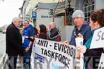 silent Protest against bank evictions on Thursday. Frank Shaw (Mgr Bank Of Ireland Tralee) talks to the Anti eviction task force