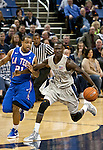 March 3, 2012:   Nevada Wolf Pack Patrick Nyelo is fouled as he drives past Louisiana Tech Bulldogs Kenyon McNeail during their NCAA basketball game played at Lawlor Events Center on Saturday night in Reno, Nevada.
