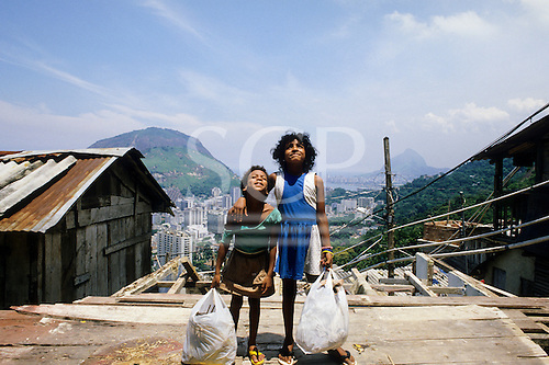 Rio de Janeiro, Brazil. Favela shanty town; two poor children from a shanty town.