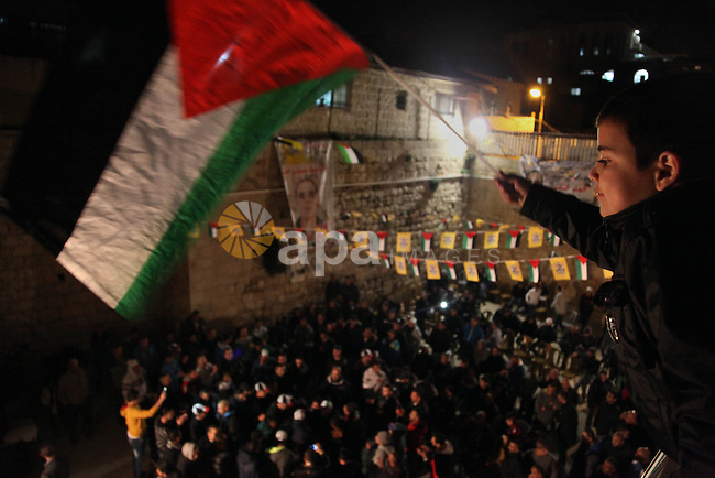 Palestinians take part during celebrate the release of Palestinian prisoner Ahmad Khalaf in Jerusalem January 3, 2013. which formally launched the Middle East peace process, and have served 19 to 28 years for killing Israeli civilians or soldiers. Photo by Saeed Qaq