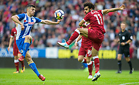 Mohamed Salah of Liverpool & Jordan Flores of Wigan Athletic during the pre season friendly match between Wigan Athletic and Liverpool at the DW Stadium, Wigan, England on 14 July 2017. Photo by Andy Rowland.