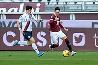 12th January 2020; Olympic Grande Torino Stadium, Turin, Piedmont, Italy; Serie A Football, Torino versus Bologna; Sasha Lukic of Torino FC breaks on the ball covered by Riccardo Orsolini of Bologna - Editorial Use