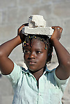 A girl helps carry building debris in Port-au-Prince, Haiti, in the wake of a devastating earthquake that shook the Caribbean island nation on January 12.