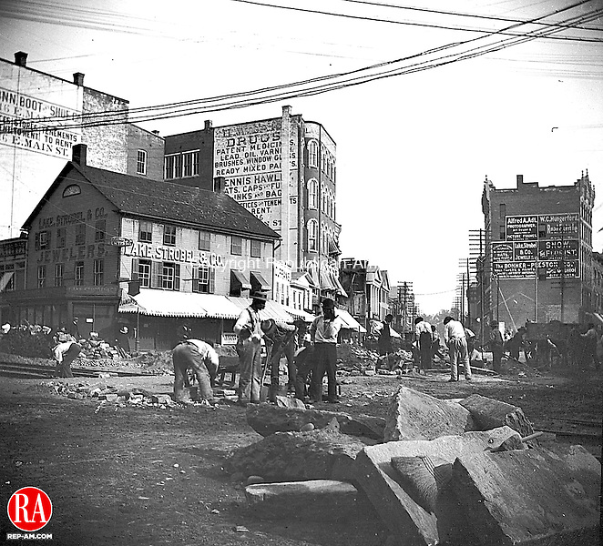 Laying tracks for the trolley at Exchange Place in downtown Waterbury, circa 1894.