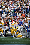 6 Robbie Bosco jumps over a player as he runs against the Universtiy of Wyoming.<br /> <br /> Sept/Oct. 1984<br /> <br /> FTB 1984 461<br /> <br /> Photo by Mark Philbrick/BYU<br /> <br /> &copy; BYU PHOTO 2009<br /> All Rights Reserved<br /> photo@byu.edu  (801)422-7322