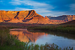 Grand County, UT<br /> Reflections in the Colorado River with Fisher Towers and La Sal Mountains in the distance in afternoon light.