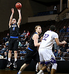 SIOUX FALLS, SD - MARCH 12:  Evan Henry #5 from St. Francis spots up for a jumper against the College of Idaho during their semifinal game at the 2018 NAIA DII Men's Basketball Championship at the Sanford Pentagon in Sioux Falls. (Photo by Dave Eggen/Inertia)