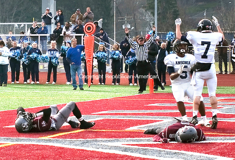 Naugatuck, CT- 26 November 2015-112615CM04-  Ansonia's Tyler Bailey (5) celebrates with teammate Dante D'Ambrosie (7) after D'Amrosie scores a touchdown during their Thanksgiving matchup against Naugatuck on Thursday.  On the ground are Naugatuck's Antoine Sistrunk (left) and Dan Oladapo. The Chargers would rout the Greyhounds,  41-8.   Christopher Massa Republican-American