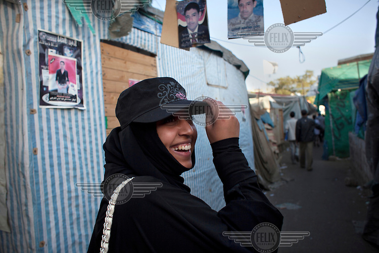Shatha Al-Harazi, a young female activist walks through Change Square where the revolution in Yemen took place.