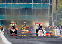Mar 18, 2018; Gainesville, FL, USA; NHRA top fuel driver Steve Torrence (right) crosses the centerline and hits a timing block against Mike Salinas during the Gatornationals at Gainesville Raceway. Mandatory Credit: Mark J. Rebilas-USA TODAY Sports