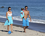 July 15th 2012   Sunday  <br /> <br /> Malibu California beach house Party <br /> Eva Longoria wearing a gray dress talking to Mario Lopez &amp; girlfriend Courtney Laine Mazza &amp; daughter Gia playing on the beach &amp; swimming in the ocean. <br /> Stephen Dorff was also shirtless at the party with Mario <br /> <br /> Mario was hugging and kissing his girlfriend on the balcony &amp; playing paddle tennis<br /> Running jogging in a swimsuit showing off his six pack abs<br /> <br /> AbilityFilms@yahoo.com<br /> 805 427 3519<br /> www.AbilityFilms.com