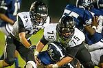 Lawndale, CA 10/18/13 - Mike Pettis (Peninsula #75), Ryan Augello (Peninsula #29) and Nathaniel Vaughn  (Leuzinger #3) in action during the Peninsula vs Leuzinger Varsity football game at Leuzinger High School.