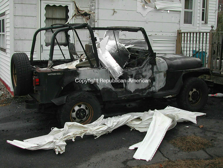 PLYMOUTH, CT - 24 Nov. 2008 - 112408KM01 - This Jeep Wrangler at 68 Main St. in Plymouth was destroyed by fire Monday. Fire Marshal John F. Schubert said Lorraine Armbruster came out of her home about 8 a.m. and started her 1993  Wrangler to warm it up. When she came back a few minutes later, flames were shooting out of dashboard vents The Jeep was parked in the driveway next to the two-story house. The fire melted some of the siding. Schubert said the fire was caused by either a short circuit or the carburetor backfiring. No one was hurt.  Kurt Moffett Republican-American