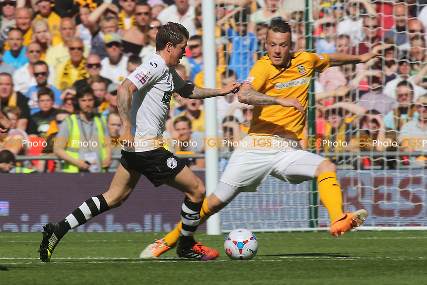 John Oster of Gateshead takes on the Cambridge defence - Cambridge United vs Gateshead - Skrill Football Conference Promotion Play-Off Final at Wembley Stadium, London - 18/05/14 - MANDATORY CREDIT: Paul Dennis/TGSPHOTO - Self billing applies where appropriate - 0845 094 6026 - contact@tgsphoto.co.uk - NO UNPAID USE