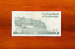 One pound Scottish currency note on table showing print of Edinburgh Castle