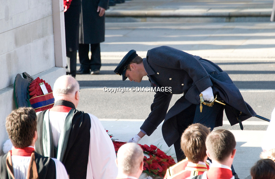 """PRINCE WILLIAM LAYS A WREATH AT THE CENOTAPH WHILE KATE WATCHES FROM THE BALCONY.Kate's attended her 1st Remembrance Service with members of the Royal Family at the Cenotaph, London_13th November 2011.Photo Credit Mandatory: ©Dias/DIASIMAGES..Mandatory credit photo:©DIASIMAGES(Failure to credit will incur a surcharge of 100% of reproduction fees)..**ALL FEES PAYABLE TO: """"NEWSPIX  INTERNATIONAL""""**..IMMEDIATE CONFIRMATION OF USAGE REQUIRED:.DiasImages, 31a Chinnery Hill, Bishop's Stortford, ENGLAND CM23 3PS.Tel:+441279 324672  ; Fax: +441279656877.Mobile:  07775681153.e-mail: info@newspixinternational.co.uk"""
