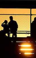 Oct. 5, 2012; Mohnton, PA, USA: NHRA fans in the grandstands as the sun sets during qualifying for the Auto Plus Nationals at Maple Grove Raceway. Mandatory Credit: Mark J. Rebilas-
