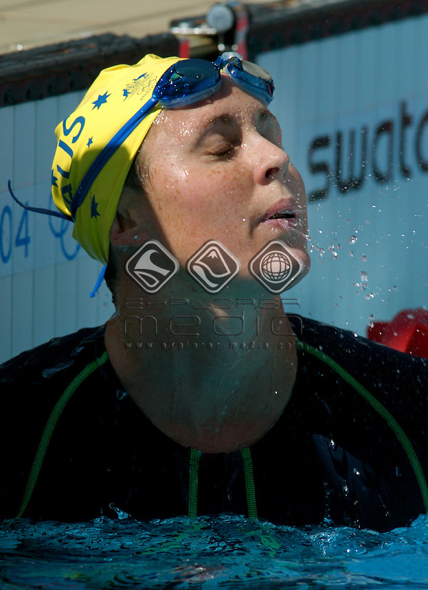 Petria Thomas (AUS) 100m butterfly<br /> Swimming heats <br /> Summer Olympics - Athens, Greece 2004<br /> Day 1, Sat 14th August 2004.<br /> &copy; Sport the library/Jeff Crow