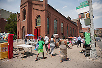 A small flea market outside of the Church of St. Joseph of the Holy Family in Harlem in New York on Saturday, July 16, 2016.  (© Richard B. Levine)