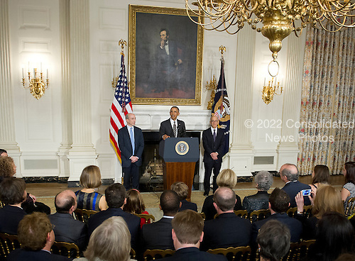 United States President Barack Obama announces his intent to nominate Timothy Massad as Chairman of the Commodity Futures Trading Commission (CFTC) during an event in the State Dining Room of the White House in Washington, D.C. on Tuesday, November 12, 2013.  From left to right: Gary Gensler, Chairman, Commodity Futures Trading Commission; President Obama; and Timothy Massad, Chairman-designate of the Commodity Futures Trading Commission<br /> Credit: Ron Sachs / Pool via CNP