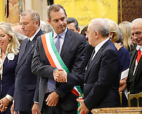 The mayor of Naples Luigi De Magistris and Vincenzo De Luca , governator of Campania shakes the hands  during  the liquefaction of the blood of San Gennaro, the patron saint of Naples, during the San Gennaro miracle announcement in the cathedral of Naples, 19 September 2016