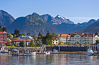 "View across the Sitka Harbor, from Japonski Island, overlooking the coastal fishing community of Sitka, on Baranof Island, southeast, Alaska. Commercial fishing vessel, ""Swift"" passes through Sitka Channel."