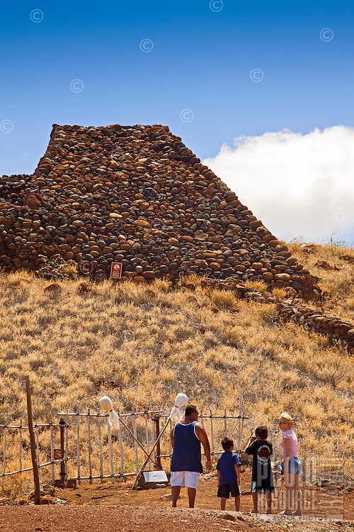 A family viewing Pu'ukohola Heiau (a.k.a. the temple on the whale hill), the largest and last heiau constructed in 1790-91 by Kamehameha I, Pu'ukohola Heiau National Historic Site, Kawaihae, Kohala, Big Island.