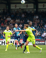 Anthony Stewart of Wycombe Wanderers battles with Chris Porter of Colchester United during the Sky Bet League 2 match between Wycombe Wanderers and Colchester United at Adams Park, High Wycombe, England on 27 August 2016. Photo by Liam McAvoy.