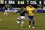 Colombian player Falcao Garcia (L) fights for the ball with Brazilian player Thiago Silva during their friendly match at MetLife Stadium in East Rutherford New Jersey, November 14, 2012. Photo by Eduardo Munoz Alvarez / VIEWpress.