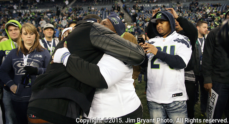 Seattle Seahawks  wide receiver Richardo Lockette, hugs Mama Lynch. Lockette, who was injured in the game against Dallas Cowboys on November 1,  stands on the sideline before their game against the Arizona Cardinals at CenturyLink Field in Seattle, Washington on November 15, 2015. The Cardinals beat the Seahawks 39-32.   ©2015. Jim Bryant photo. All Rights Reserved.