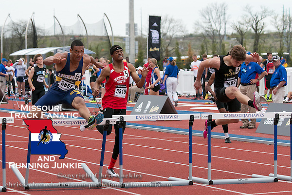 Liberty North's Andrew Madison leads Canon City's Trenton Stringari (#4) and Raytown South's Quincy Hall over the final hurdle in the 300-meter hurdles at the 2015 Kansas Relays. Madison was second in 38.24, Hall third in 38.38, and Stringari fourth in 38.39.