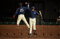 Mobile BayBears Jahmai Jones (15) celebrates with Jhoan Urena (right) after hitting a home run during a Southern League game against the Jacksonville Jumbo Shrimp on May 7, 2019 at Hank Aaron Stadium in Mobile, Alabama.  Mobile defeated Jacksonville 2-0.  (Mike Janes/Four Seam Images)