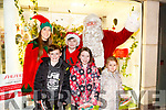 Enjoying the CH Chemist Customer Evening and meeting Santa and elf on Friday were Luke O'Sullivan, Ben O'Sullivan, Kelly O'Sullivan and Hayley Callaghan