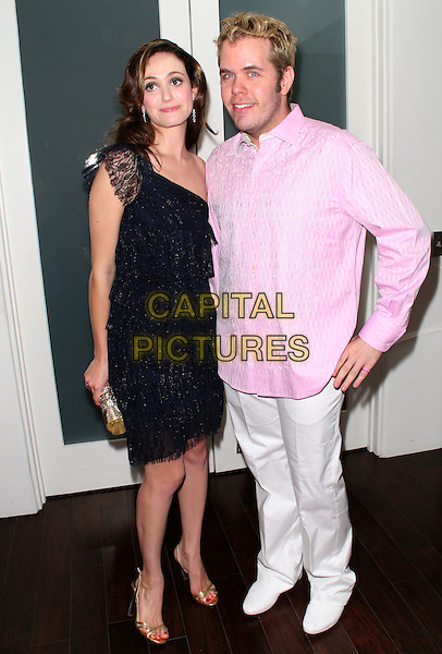 EMMY ROSSUM & PEREZ HILTON.Attending Pinkitude, an event inspired by MGM to benefit the Susan G. Komen for the cure breast cancer charity, held at Zune LA, Los Angeles, California, .14 August 2008..full length pink shirt black lace dress tiered one shoulder white trousers gold clutch bag shoes sandals .CAP/ADM/FS.©Faye Sadou/Admedia/Capital Pictures