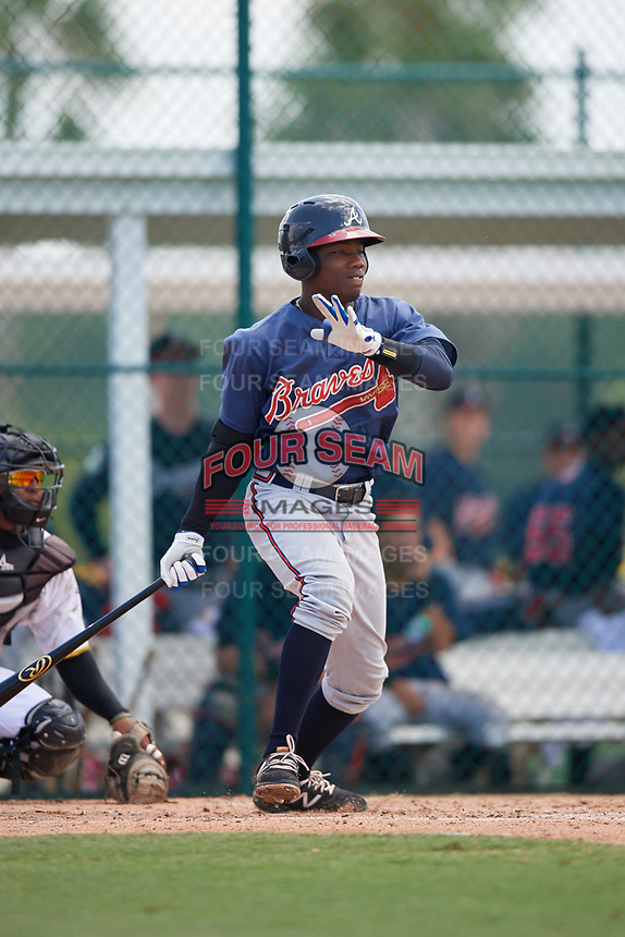 GCL Braves designated hitter Yunior Severino (28) follows through on a swing during a game against the GCL Pirates on July 26, 2017 at Pirate City in Bradenton, Florida.  GCL Braves defeated the GCL Pirates 12-5.  (Mike Janes/Four Seam Images)