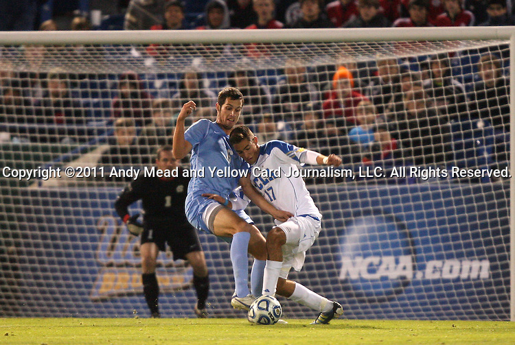 09 December 2011: North Carolina's Matt Hedges (6) and UCLA's Chandler Hoffman (17). The University of California Los Angeles Bruins played the University of North Carolina Tar Heels to a 2-2 tie after overtime, with the Tar Heels advancing with a 3-1 win in the penalty kick shootout at Regions Park in Hoover, Alabama in an NCAA Division I Men's Soccer College Cup semifinal game.
