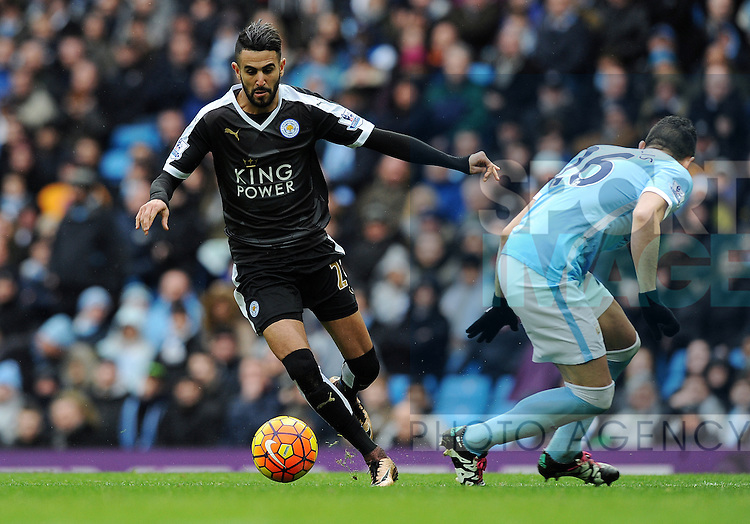 Riyad Mahrez of Leicester City goes round Fernandinho of Manchester City to score his goal to make it 2-0<br /> - Barclays Premier League - Manchester City vs Leicester City - Etihad Stadium - Manchester - England - 6th February 2016 - Pic Robin Parker/Sportimage