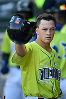 Right fielder Brian Sharp (7) of the Columbia Fireflies is greeted in the dugout after scoring a run in a game against the Augusta GreenJackets on Friday, May 31, 2019, at Segra Park in Columbia, South Carolina. Augusta won, 8-6. (Tom Priddy/Four Seam Images)