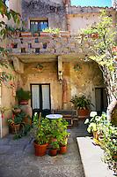 Courtyard of a house in Érice, Erice, Sicily stock photos.