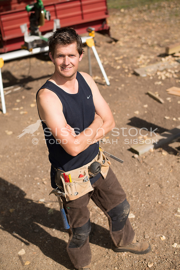Home handyman | builder standing in construction site, New Zealand- stock photo, canvas, fine art print