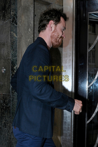 Michael Fassbender.spotted in London, England..May 30th, 2012.half length profile blue jacket beard facial hair side  .CAP/IA.©Ian Allis/Capital Pictures.
